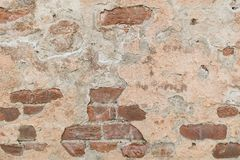 Cracked plaster on the brick wall royalty free stock photos