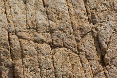 Cracked and porous red stone texture Royalty Free Stock Photos