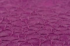Cracked purple paint on the metal, backgrounds. Abstract background, empty template. Selective focus royalty free stock image