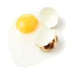 Cracked raw quail egg with yolk isolated over white background Royalty Free Stock Photos