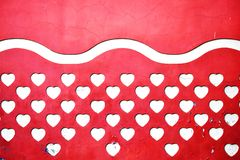 Reddish facade with a light yellow hearts stock image