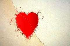 Cracked red heart on concrete wall Royalty Free Stock Photography