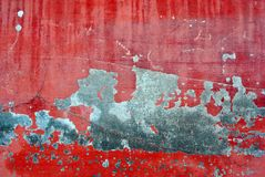 Cracked red paint on gray wall, grunge horizontal shabby background detail. Close up royalty free stock images