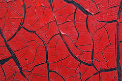 Cracked red paint on grunge metal surface - macro 11. Close up,macro photography of cracked red paint on grunge metal rough surface - small part of an old dirty Royalty Free Stock Photo