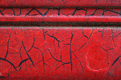 Cracked red paint on grunge metal surface - macro 9. Close up,macro photography of cracked red paint on grunge metal rough surface - small part of an old dirty Royalty Free Stock Images