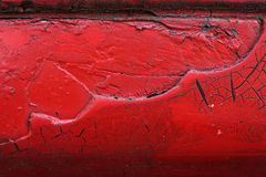 Cracked red paint on grunge metal surface - macro 8. Close up,macro photography of cracked red paint on grunge metal rough surface - small part of an old dirty Royalty Free Stock Photography