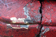 Cracked red paint on grunge metal surface - macro 3. Close up,macro photography of cracked red paint on grunge metal rough surface - small part of an old dirty Royalty Free Stock Photography