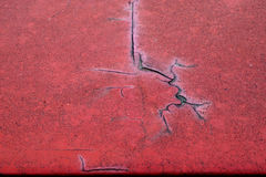 Cracked red paint on grunge metal surface - macro 1 stock photos