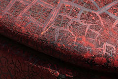 Cracked red paint on grunge metal surface - macro stock photography