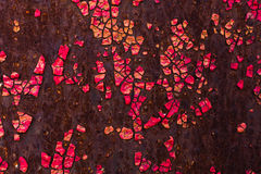 The cracked red paint on the old metallic surface. Royalty Free Stock Photos