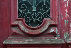 Cracked red paint on old vintage door. Detail. Lisboa, Portugal royalty free stock images
