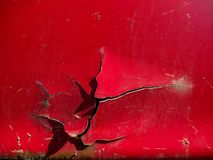 Cracked red paint, rust details on old abandoned car. On a bright sunny day royalty free stock photo