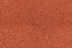 Cracked red textured surface seamlessly tileable. Cracked red textured surface background, seamlessly tileable Royalty Free Stock Photos