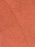 Cracked on red wall Stock Photo
