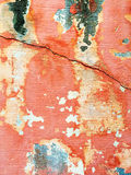 Cracked red wall with peeling paint Royalty Free Stock Photo