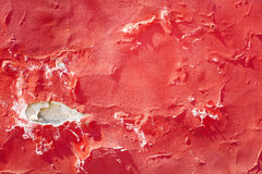 Cracked red wall Stock Photos