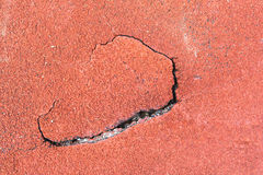 Cracked Red wet running track in stadium for design, website Royalty Free Stock Photos