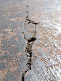 Cracked road. Close-up view of a cracked road Royalty Free Stock Photography