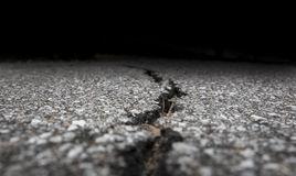Cracked road on asphalt close up Royalty Free Stock Photos