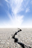 Cracked road with cloud Royalty Free Stock Images