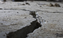 Cracked road concrete close up stock images