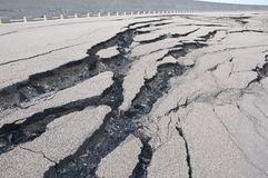 Cracked road after the disaster. Rupture of the road after the earthquake hurricane royalty free stock image
