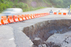 Cracked road after earthquake with yellow barricade. royalty free stock image
