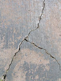 Cracked road I. Close-up view of a cracked road Stock Photos