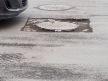 Cracked road surface. In big russian city Stock Photo