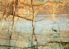 Cracked rock on seacoast backdrop. The cracked yellow rock on seacoast backdrop Stock Images