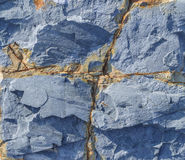 Cracked rock texture tone serenity. Textured background rock hue serenity, with a cruciform crack Stock Photography