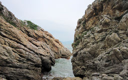 The cracked rocks in huizhou daya bay Royalty Free Stock Photography