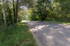 Cracked Rural Road. Old cracked, damaged asphalt road in countryside Stock Images