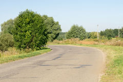 Cracked Rural Road. Old cracked, damaged asphalt road in countryside Stock Image