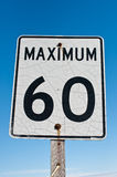 Cracked and Rusted Maximum 60 Sign. A weathered looking speed sign with a blue sky in the background Royalty Free Stock Images