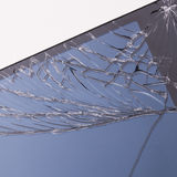 Cracked mobile phone screen. Close up image of a badly cracked mobile phone screen stock photography