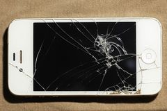 Cracked screen mobile telephone stock photo