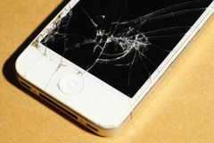 Cracked screen mobile telephone. It royalty free stock photography