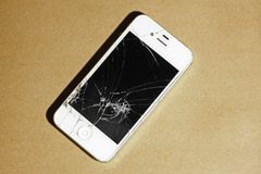 Cracked screen mobile telephone. It stock images