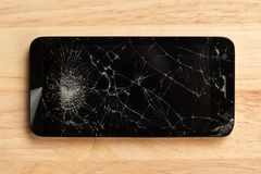 Cracked screen of smartphone mobile black glasses top view photography. stock photography