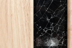 Cracked screen of smartphone mobile black glasses top view photography. royalty free stock photos