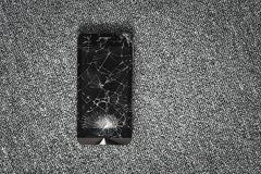 Cracked screen of smartphone mobile black glasses top view photography. royalty free stock photography
