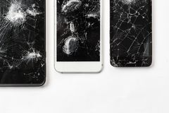 Cracked screen of smartphone mobile black glasses top view photography. stock images