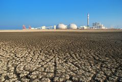 Cracked Seabed. A Power Plant constructed in front of the dried and cracked Seabed Royalty Free Stock Image