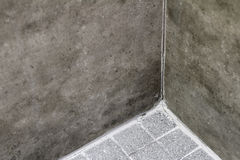 Cracked Shower Floor Corner Grout. Grout in a home shower corner between wall and floor that is cracked and split. A domestic shower that has split grout in stock photo