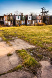 Cracked sidewalk and abandoned row houses in Baltimore, Maryland Royalty Free Stock Images
