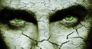 Cracked skin. Cracked and dry skin on a man`s face, with diabolic eyes