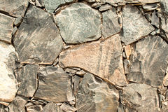 Cracked Slate Wall. Pieces of slate cemented together to make wall Stock Photo