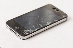 Cracked smashed lcd display touch screen on the smartphone Royalty Free Stock Image