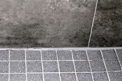Cracked and Split Shower Tile Grout. Bottom wall floor corner cracked shower tile grout in need of resealing split. Cracked bathroom shower tile grout corner stock image